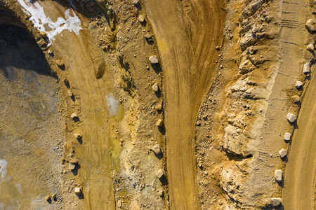 Aerial view of opencast mining quarry with lots of machinery. Industrial place view from above. Photo captured with drone.