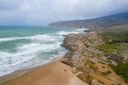 Aerial view of famous Guincho Beach in Cascais near Lisbon, Portugal. Photo made from above by drone.