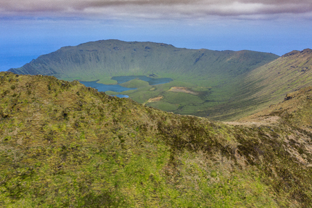 Aerial view of volcanic crater (Caldeirao) with a beautiful lake on the top of Corvo island. Azores islands, Portugal. Stok Fotoğraf