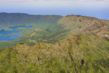 Aerial view of volcanic crater (Caldeirao) with a beautiful lake on the top of Corvo island. Azores islands, Portugal. Imagens