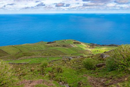 Hill of farm fields in the Corvo island in Azores, Portugal.
