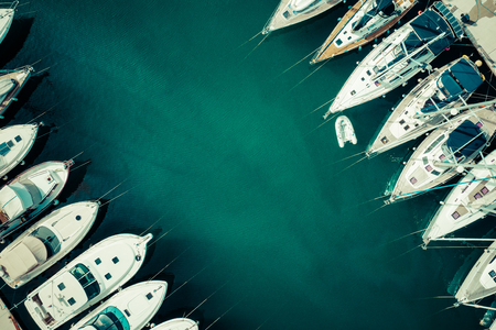 Aerial view of a lot of white boats and yachts moored in marina. Photo made by drone from above. Archivio Fotografico