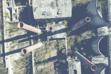 Aerial top view of abandoned industrial place. Photo made by drone from above.