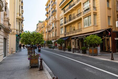 MONTE CARLO, MONACO - JUNE 04, 2019: Beautiful old architecture style of residential buildings in the old city center in Monte Carlo in Monaco Publikacyjne