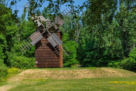 CHORZOW, POLAND - JUNE 27, 2019: A wooden windmill located in open-air museum in Chorzów. Heritage park. Upper Silesian Ethnographic Park in Chorzów.