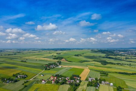 Aerial view of farmlands and mountains in rural Poland seen from drone. Summer time. 版權商用圖片