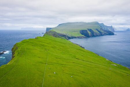Aerial view of Mykines island in Faroe Islands, North Atlantic Ocean. Photo made by drone from above. Nordic natural landscape. Stok Fotoğraf