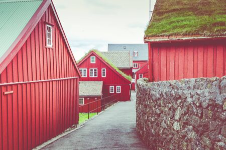 Old town of capital city of Torshavn. Typical houses with peat roof ( grass roof ). Faroes Islands. Denmark. Europe. Reklamní fotografie