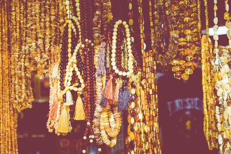 Amber pendants and necklaces at the street market of Curonian Spit, Kaliningrad region, Russia.