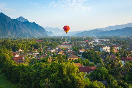 Hot air balloon over Nam Song river at sunrise in Vang vieng, Laos. Asia.
