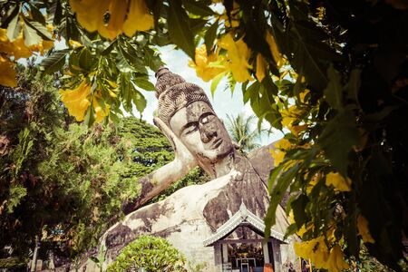 Buddha park Xieng Khouane in Vientiane, Laos. Famous travel tourist landmark of Buddhist stone statues and religious figures.