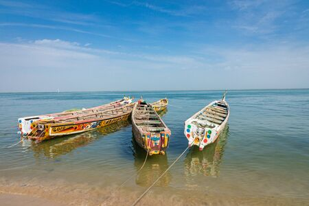 Traditional painted wooden fishing boat in Djiffer, Senegal. West Africa.