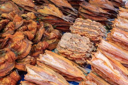 Nan khem or dried water buffalo skin and dried salted fish sold in Luang Prabang morning market in Laos. Фото со стока