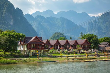 Village and mountain in Vang Vieng, Laos and Nam Song rive , Laos. Southeast Asia.