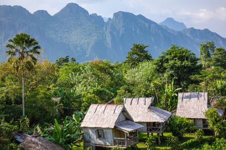 Village and mountain in Vang Vieng, Laos Southeast Asia.