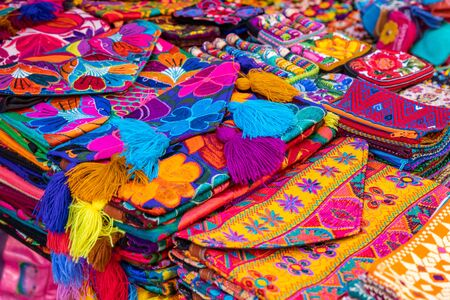 Colorful Mexican crafts for sale at market, Latin America. Mexico travel background.