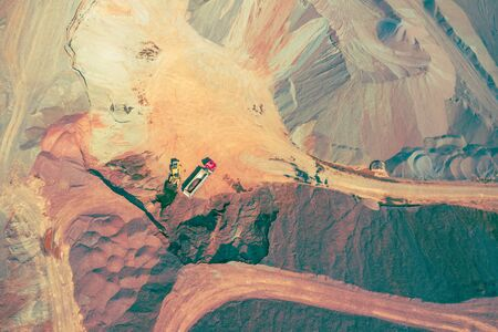 Mining from above. Industrial open pit mineral mine. Aerial view of opencast mining. Mine Excavation. Extractive industry. Giant excavator machinery. Banque d'images