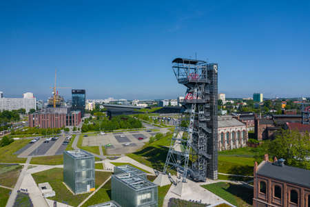 """KATOWICE, POLAND - MAY 27, 2020: The modern buildings of Silesian Museum accompanied by a shaft of the former coal mine """"Katowice"""", now adapted as an observation tower. Publikacyjne"""