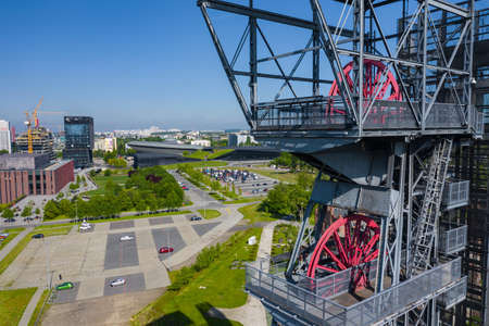 """KATOWICE, POLAND - MAY 27, 2020: The modern buildings of Silesian Museum accompanied by a shaft of the former coal mine """"Katowice"""", now adapted as an observation tower."""