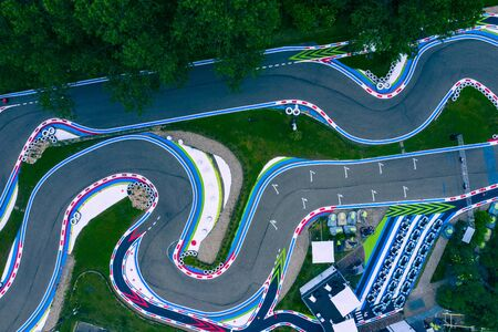 Aerial drone view of a kart racing in the forest, view from above.
