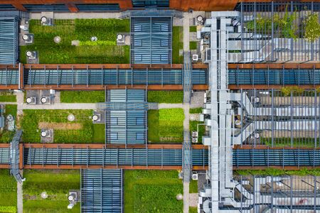 Air Condition Ventilation System Green Grass Ecology. Building Roof. Industrial Air system of ventilation and Air conditioning. Aerial Shot.