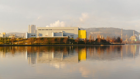 mid distance: Factory halls situated on the fjord, autumn day, the city of Skien. South Norway. Telemark region of Norway