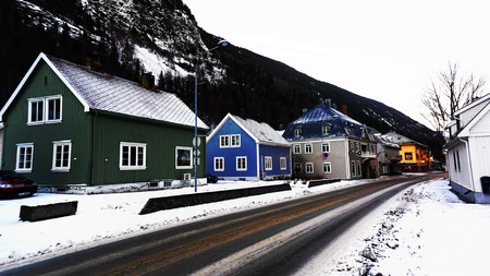 mountaintop: Colorful wooden houses and buildings on the central street. Late in the afternoon. Norwegian winter. Rjukan in Telemark region of Norway