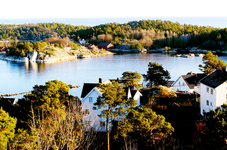 kristiansand: View of the North Sea and on the fjord, over the roofs of the wooden houses. North Sea Coast. Norwegian winter. Risor, Aust-Agder region of Ostlandet. Eastern Norway.