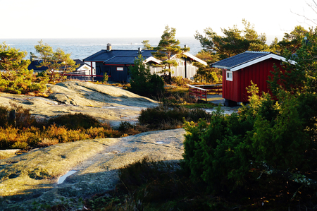 The view over the rooftops, summer cabin, abandoned n winter the water and slip-ups shelf. Around the old pine trees. Norwegian winter. Telemark region of Ostlandet. Eastern Norway. photo