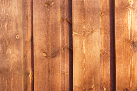 wood stain: Brown planks, painted wood stain. Seki and visible crack in the tree. Here and there you can see their heads of nails.
