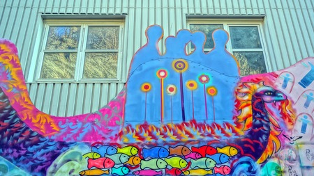 munch: Street graffiti and mural on the facade school students Norwegian Art School in Kragero. Edvard Munch Nearby painted his paintings.