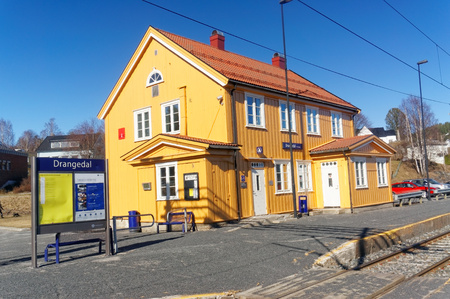thorium: Drangedal, Norway, March 21, 2015: Traditional Norwegian wooden building railway station in small city Drangedal. Early spring.