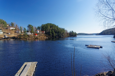 riverine: Drangedal, Norway, March 21, 2015: View of the Norwegian lake Tokevann consisting of the upper and Lower Toke. Flows through the city: Bamble,  Kragero, Drangedal. Early spring. Editorial
