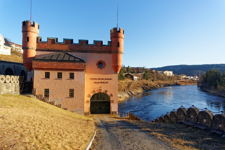 hydro power: Notodden, Norway, March 21, 2015:  Tinfos brick building hydro power plant in Notodden city. Tinnelva river bank. Early spring.