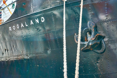 county side: Stavanger, Norway - July 26, 2015: And riveted metal from the ships side pulled anchor. Fjord - Boknafjord, county Rogaland region Vestlandet. Editorial