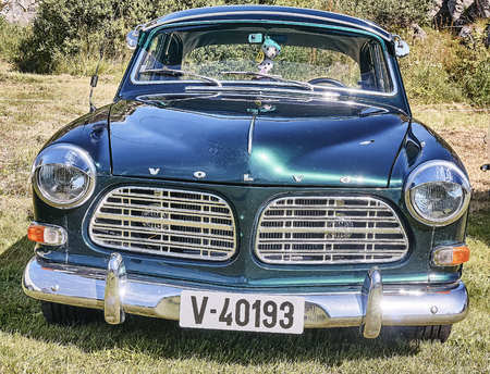islanders: Froya island, Norway - 24 July 2016: Front of the classic car in dark green  at cars show in norwegian Islanders Classic Car Club - Kysttreffet 2016.  Island in the Atlantic Ocean and Norwegian fjord.