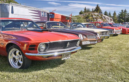 Froya island, Norway - 24 July 2016: Side of the classic colorful cars at cars show in norwegian Islanders Classic Car Club - Kysttreffet 2016.  Island in the Atlantic Ocean and Norwegian fjord.
