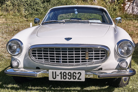 rebuild: Froya island, Norway - 24 July 2016: Front of the classic car in  white cream  at cars show in norwegian Islanders Classic Car Club - Kysttreffet 2016.  Island in the Atlantic Ocean and Norwegian fjord.