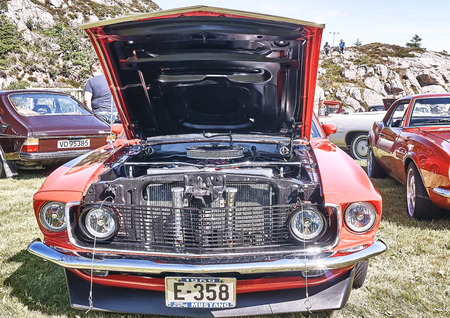 rebuild: Froya island, Norway - 24 July 2016: Front of the classic Ford Mustang car from 1969 at cars show in norwegian Islanders Classic Car Club - Kysttreffet 2016.  Island in the Atlantic Ocean and Norwegian fjord. Editorial