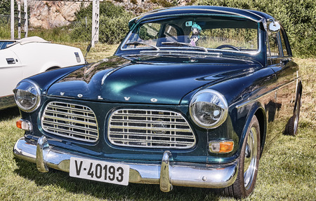 islanders: Froya island, Norway - 24 July 2016: Side of the classic Volvo car in dark green  at cars show in norwegian Islanders Classic Car Club - Kysttreffet 2016.  Island in the Atlantic Ocean and Norwegian fjord. Editorial