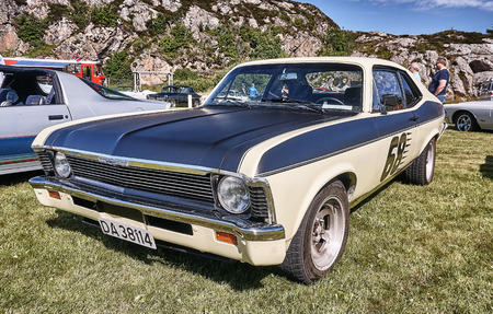 islanders: Froya island, Norway - 24 July 2016: Side of the classic car in black and  yellow cream  at cars show in norwegian Islanders Classic Car Club - Kysttreffet 2016.  Island in the Atlantic Ocean and Norwegian fjord.