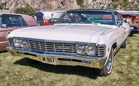 rebuild: Froya island, Norway - 24 July 2016: Side of the classic Chevrolet car in  white cream at cars show in norwegian Islanders Classic Car Club - Kysttreffet 2016.  Island in the Atlantic Ocean and Norwegian fjord. Editorial