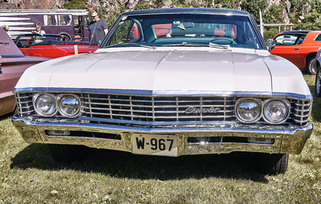 Froya island, Norway - 24 July 2016: Front of the classic Chevrolet car in  white cream at cars show in norwegian Islanders Classic Car Club - Kysttreffet 2016.  Island in the Atlantic Ocean and Norwegian fjord.