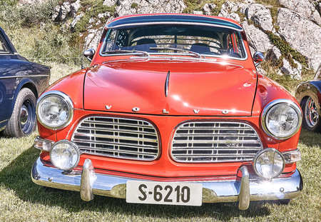 Froya island, Norway - 24 July 2016: Front of the classic Volvo car in red  at cars show in norwegian Islanders Classic Car Club - Kysttreffet 2016.  Island in the Atlantic Ocean and Norwegian fjord.