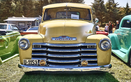 islanders: Froya island, Norway - 24 July 2016: Front of the classic Chevrolet car in yellow at cars show in norwegian Islanders Classic Car Club - Kysttreffet 2016.  Island in the Atlantic Ocean and Norwegian fjord.
