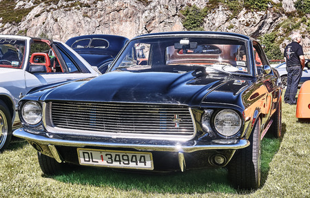 rebuild: Froya island, Norway - 24 July 2016: Front of the classic Ford Mustang car in black at cars show in norwegian Islanders Classic Car Club - Kysttreffet 2016.  Island in the Atlantic Ocean and Norwegian fjord. Editorial