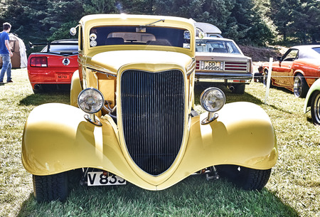 rebuild: Froya island, Norway - 24 July 2016: Front of the classic car in yellow  at cars show in norwegian Islanders Classic Car Club - Kysttreffet 2016.  Island in the Atlantic Ocean and Norwegian fjord.