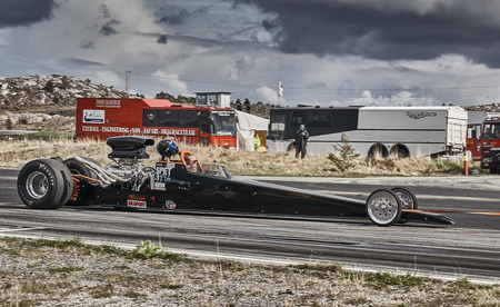 drifting: Froya, Norway, 24 June 2016: Norwegian high-skill motor sport  competitions and demonstration of fast cars drifting in Norway. Long black racing car with driver. Cars drifting, burning out, sliding, cars driving fast. Island in the Atlantic Ocean and Norw