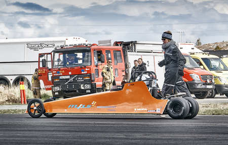 Froya, Norway, 24 June 2016: Norwegian high-skill motor sport  competitions and demonstration of fast cars drifting in Norway. Cars drifting, burning out, sliding, cars driving fast. Island in the Atlantic Ocean and Norwegian fjord.