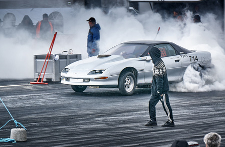 drifting: Froya, Norway, 24 June 2016:  Cars drifting, burning out, sliding, cars driving fast. Island in the Atlantic Ocean and Norwegian fjord. Norwegian high-skill motor sport  competitions and demonstration of fast cars drifting in Norway.